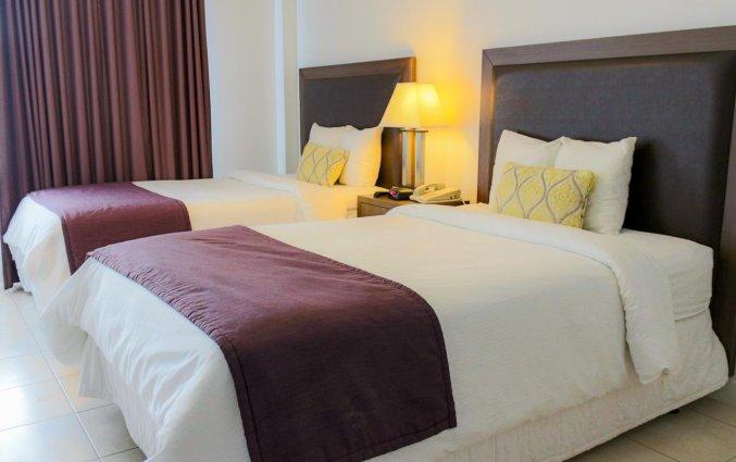 Vierpersoonskamer van collins hotel